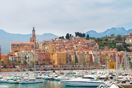 menton: colorful houses of Menton old town embankment at summer day, France Stock Photo