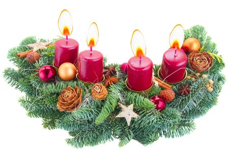 Evergreen fir tree advent wreath with burning candles  isolated on white background