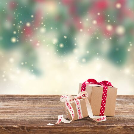 holiday background: Two handmade christmas  gift boxes on wooden table