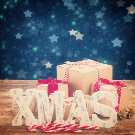 stary: Xmas letters and handmade gift boxes border, stary night at background, retro toned Stock Photo