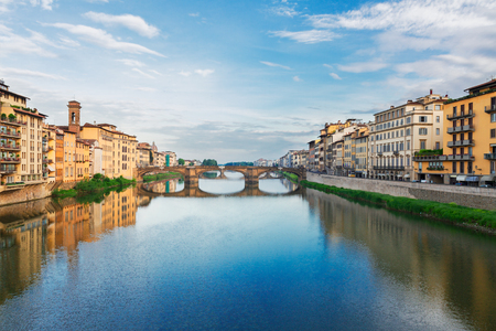 trinita: old town with bridge Santa trinita reflecting in water of river Arno, Florence, Italy Stock Photo