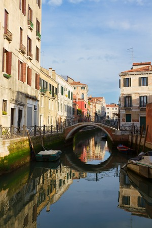 bridge over water: traitional Venice houses and bridge over water of small canal in old town, Italy
