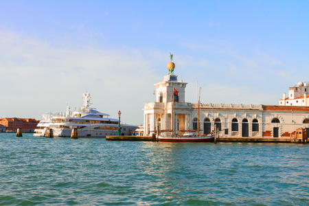 canal house: Dogana, old custom house in Venice and Grand canal, Italy
