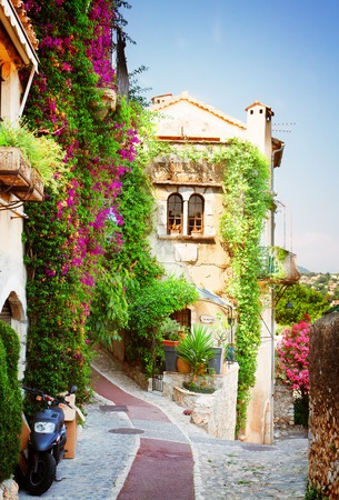 beautiful old town street of Provence at summer day, France, retro toned Standard-Bild