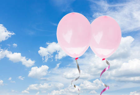 baloons: two pink baloons in the cloudy  sky