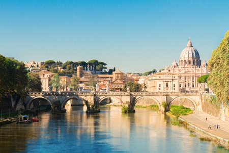 St. Peter's cathedral over bridge and river in Rome, Italy Banco de Imagens
