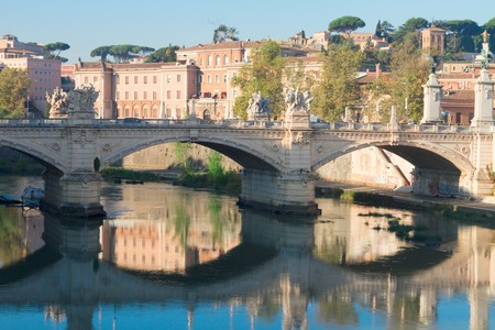 vittorio: bridge Ponte Vittorio II reflecting in Tiber river in Rome, Italy Stock Photo