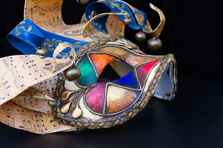 masque: venetian Mardi gras masque of  jester on black Stock Photo