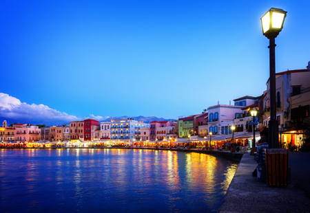 habour: waterfront of venetian habour of Chania with  Aegan sea at night, Crete, Greece, toned