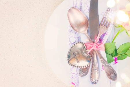silver cutlery: Valentines day dinner with vintage silver cutlery, retro toned