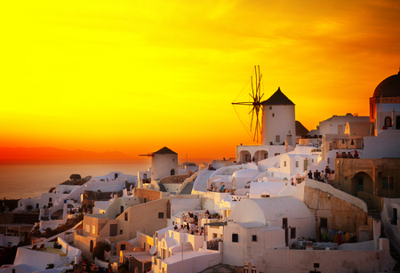 famouse sunset of Oia with windmill, Santorini, toned
