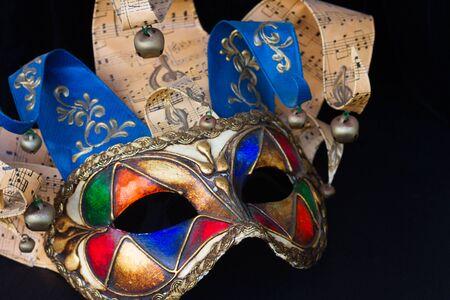 masque: venetian Mardi gras masque of  jester on black  background Stock Photo