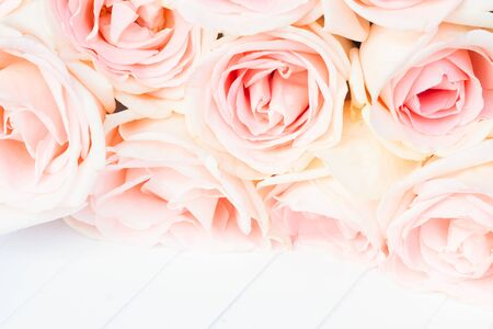 wedding bouquet: Fresh pink roses close up border on white wooden background