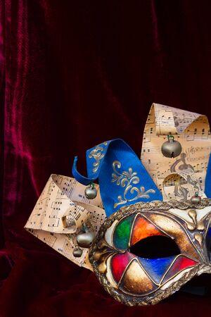 masque: venetian Mardi gras masque of  harlequin on red velvet Stock Photo