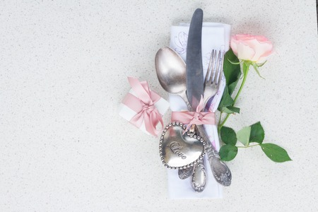 silver cutlery: Valentines day dinner concept with vintage silver cutlery