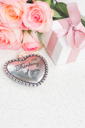 thinking of you: Thinking of You Heart with gift box and pink roses on white table