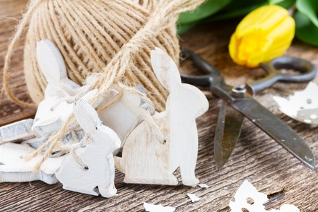 eggshell: easter bunnies with eggshell and yellow tulips on wooden table Stock Photo