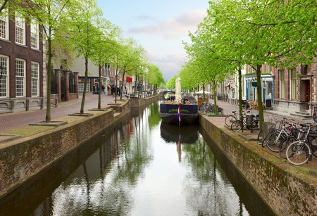 canal street: colorful street with canal in old town  of Delft, Holland