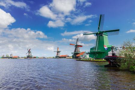 zaan: view of dutch windmills in Zaanse Schans at sunny day, Holland
