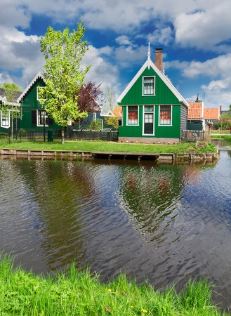 zaan: rural dutch scenery of small old houses in Zaanse Schans at spring day, Netherlands
