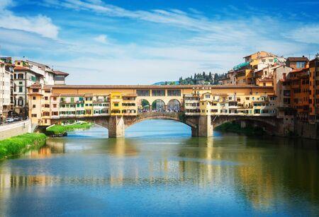 river arno: famous bridge Ponte Vecchio over waters of  river Arno, Florence, Italy, retro toned Stock Photo