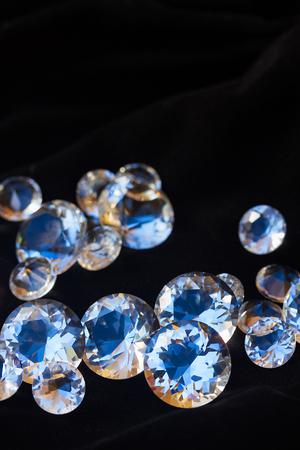 black velvet: Pile of diamonds on black velvet background, vertical shot Stock Photo
