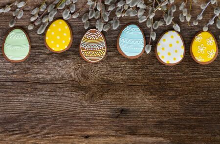 catkins: Easter border with eggs cookies and catkins on wood