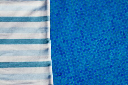 pool side: resort background with striped towel  near pool  side