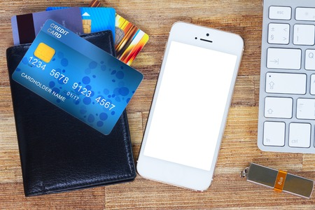 desk with mobile  phone and wallet with plastic cards