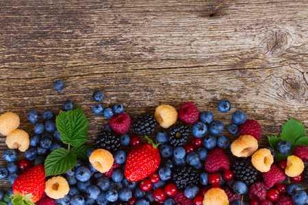 fruit mix: pile  of fresh  berries mix on wood, top view Stock Photo