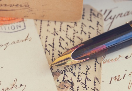 old letters: old retro golden quill pen and antique letters, retro toned