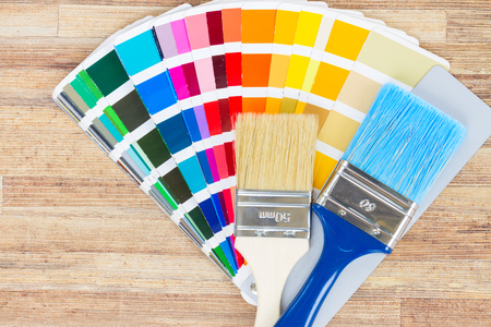 r furniture: Color palette guide and brushes on wood Stock Photo