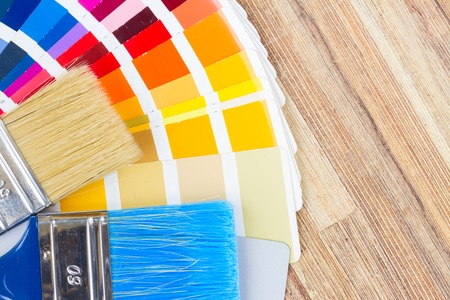r furniture: Color palette guide and brushes close up on wood Stock Photo