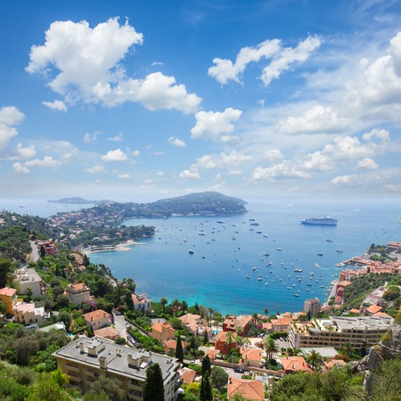 villefranche sur mer: lanscape of riviera coast, turquiose water and blue sky of cote dAzur at summer day, France Stock Photo