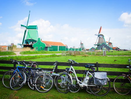 schans: dutch windmills with bikes  in Zaanse Schans, Holland, toned