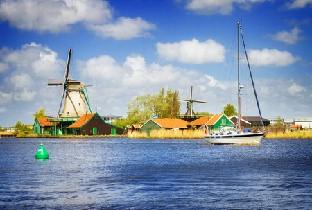zaan: dutch windmills over Zaan river, Holland, retro toned Stock Photo