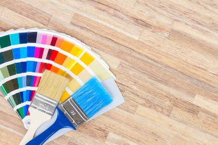 r furniture: Color palette guide and brushes on wooden background