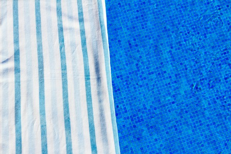 sripes: resort background with striped towel  near pool  clear water