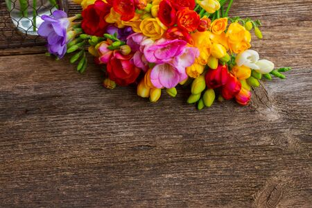 posy: Fresh freesia flowers posy on wooden table  background with copy space Stock Photo