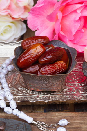 date fruit: Date fruit with rosemary in copper vase on oriental traditional tray