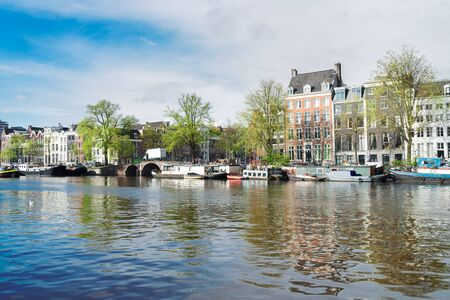 amstel: embankment of Amstel canal in Amsterdam, Netherlands Stock Photo