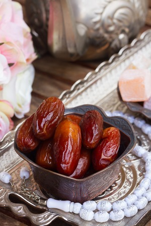 date fruit: Date fruit with white  rosemary and flowers on oriental traditional tray