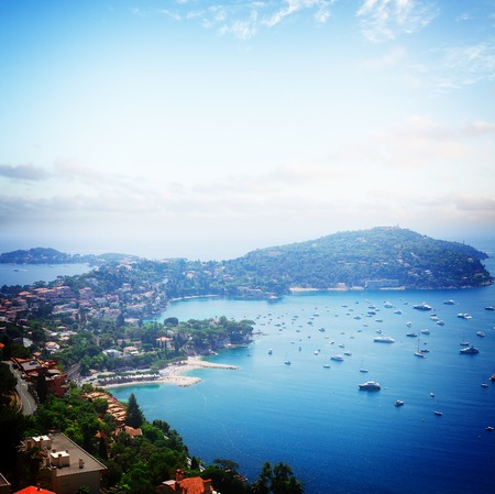 villefranche sur mer: lanscape of coast and turquiose water of cote dAzur, French Riviera, France, retro toned
