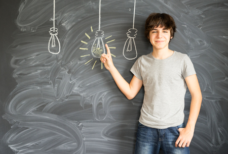 idea: Teenager boy getting an idea - back to school education concept Stock Photo