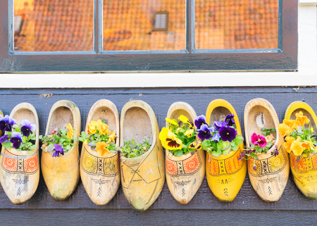 clogs: Traditional dutch shoes clogs with fresh flowers Stock Photo