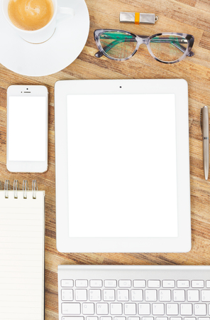 web screen: Flat lay wooden desktop with white tablet, copy space on blank screen Stock Photo