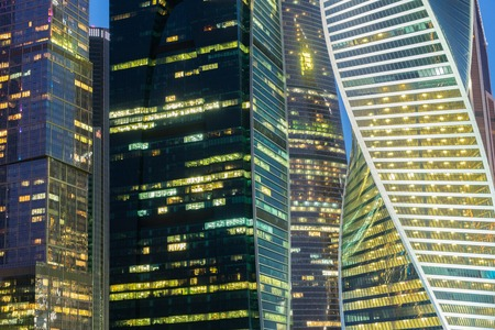 glass buildings: illuminated windows of modern glass buildings background