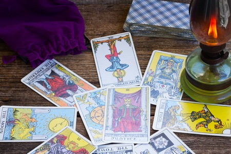 divination: View of fortunetelling set with one of the most popular occult Tarot deck dating back 1910 Stock Photo