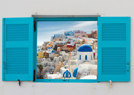 window with cityscape of Oia, traditional greek village of Santorini, Greece
