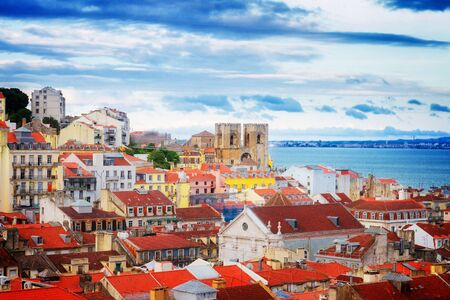 bairro: view of Lisbon over old town quarters with Se cathedral, Portugal, retro toned